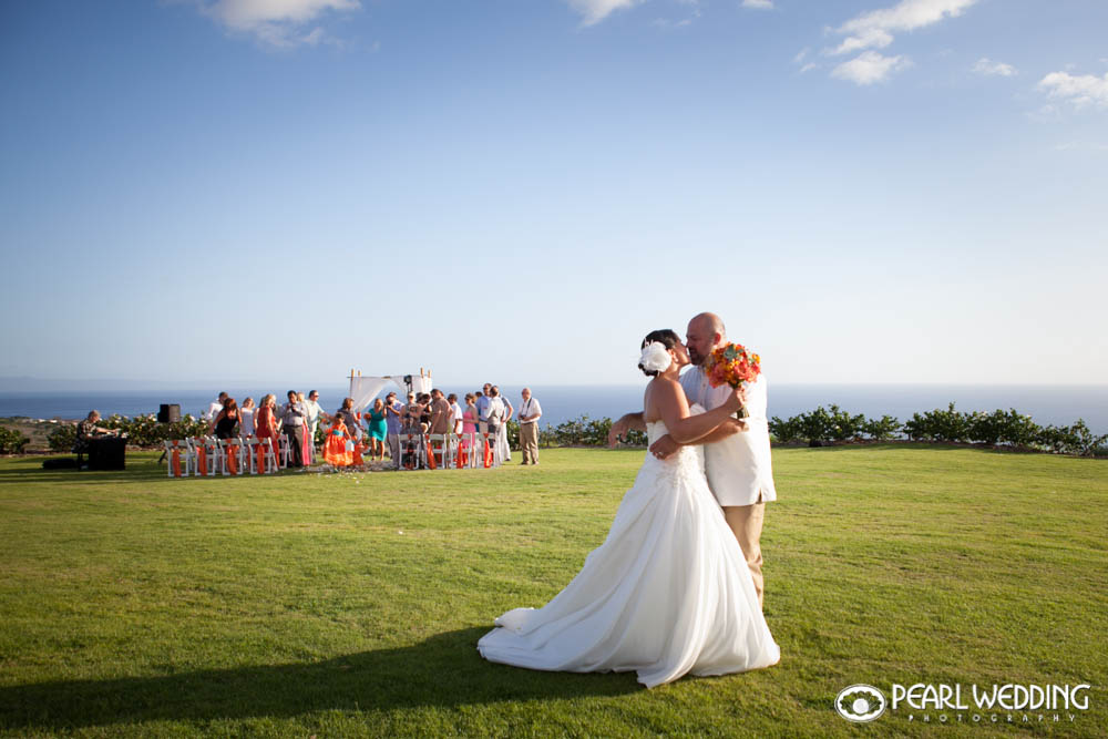 Kissing the bride on the Infinity Lawn.